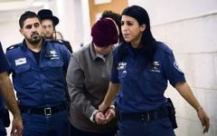 Malka Leifer being led into the Jerusalem District court last February. Photo: EPA