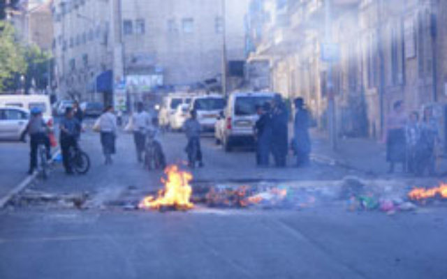 Some streets in Jerusalem were blocked with fires in protest on Thursday.