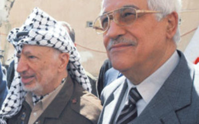 The late Yasser Arafat (left) with current Palestinian Authority President Mahmoud Abbas. Photo: AJN file