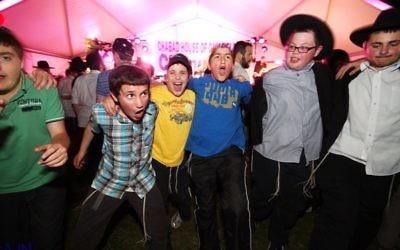 Having fun at previous Chanukah celebrations. Photo: Peter Haskin