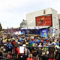 22-8-12. A packed Federation Square in Melbourne welcomes home Australia's medalists from the London 2012 Olympics.  Steve Solomon on the big screen. Photo: Peter Haskin