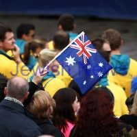 22-8-12. A packed Federation Square in Melbourne welcomes home Australia's medalists from the London 2012 Olympics.  Australian flag. Photo: Peter Haskin