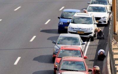 Tel Aviv drivers take cover as a siren sounds