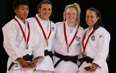 Amy Meyer (right) pictured with fellow judo medal-winners in the women's under-48kg category in Glasgow, Scotland. Photo: AP Photo/Frank Augstein