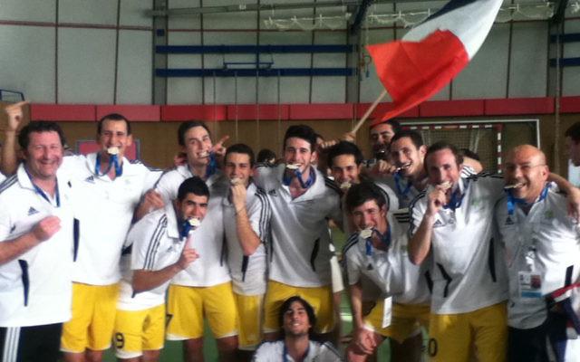 The Australian futsal team celebrates gold at the 2011 EMG.