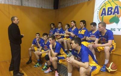 Coach Al Westover addresses the Maccabi Warriors youth team.
