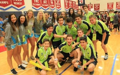Maccabi Australia's Under-14 basketball team at the JCC opening ceremony with some American girls. Photo: Michelle Israel