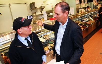 Eric Silver (left) of Solomon Kosher Butcher discussing the upcoming holiday with David Southwick. Photo: Peter Haskin