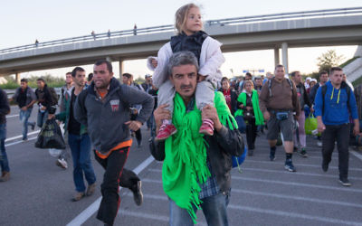 Refugees walking along a motorway near the southern Hungarian village of Roszke last week. Photo: Matt Cardy/Getty Images