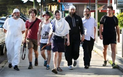 Yitzi Tuvel (centre) walking from Bondi to Lakemba Mosque accompanied by (from left) Mazen Zraika, Yehuda Aharon, Nathan Simmon, Ayman Abu Farha, Rabbi Zalman Kastel and Yanky Klein. Photo: Noel Kessel