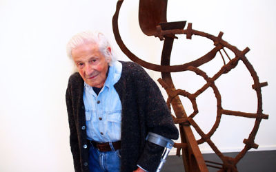 Artist Erwin Fabian with one of his steel sculptures. Photo: Peter Haskin