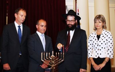Chanukah at Victorian Parliament House. From left: David Southwick,  James Merlino, Rabbi Chaim Herzog,  Myriam Boisbouvier-Wylie, honorary Consul general of France in Melbourne. Photo: Peter Haskin