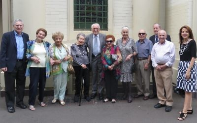 SJM CEO Norman Seligman (left) with the Holocaust survivor guides and Rony Bognar (right).