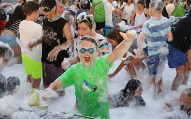 Enjoying the Junior Carnival foam party. Photo: Jessica Cohen