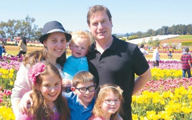 YitzchakRosen with his wife Jacqui and their four children.