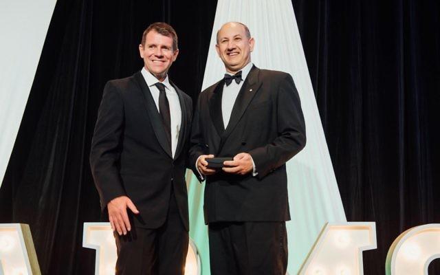 Jeremy Jones (right) receives the Harmony Award from Premier Mike Baird last week.