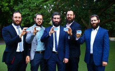 From left: Rabbi Daniel Rabin, Rabbi Chaim Cowen, Rabbi Yaakov Glasman, Rabbi Menachem Wolf and Rabbi Velly Slavin showing off their HODS cards. Photo: Peter Haskin.