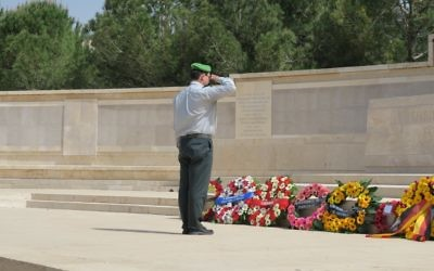 Israel Defence Forces' Colonel Moshe Pinkert laying a wreath at the ceremony in Jerusalem.