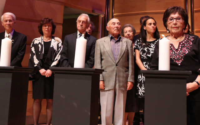 Lighting of the memorial candles at a past Yom Hashoah commemoration in Sydney. Photo: Giselle Haber