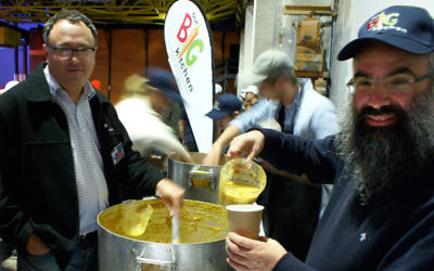 Our Big Kitchen's general manager Russel Levert and executive director Rabbi Dovid Slavin serving soup at Carriageworks in Sydney on June 23 for the Vinnies CEO Sleepout. Photo: Shane Desiatnik.
