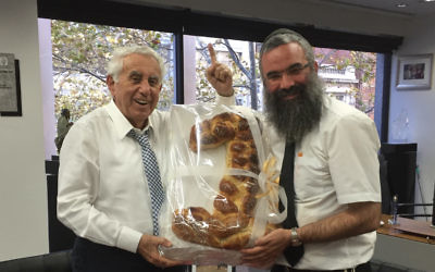 Our Big Kitchen's Rabbi Dovid Slavin took a large challah in the shape of the number one to Harry Triguboff when he was named the richest person in Australia.