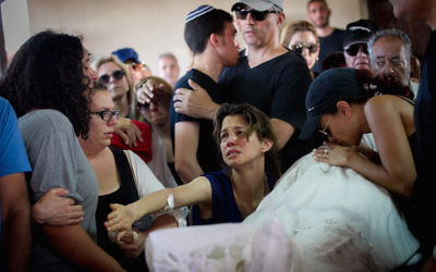 Family and friends mourning at the funeral ceremony of Ido Ben Ari. Photo: Miriam Alster/Flash90/JTA.