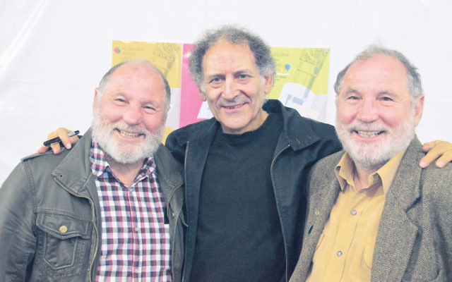 Author Arnold Zable with Henry Nissen (left) and his twin brother Leon at the Melbourne Jewish Writers Festival. Photo: Morry Frenkel