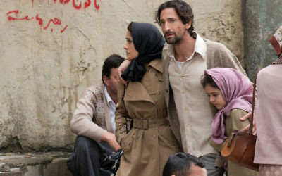 Isaac Amin (Adrien Brody), his wife Farnez (Salma Hayek) and daughter in Septembers of Shiraz.