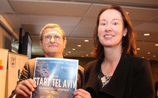 Israel's Ambassador to Australia, Shmuel Ben-Shmuel, presents the Start Tel Aviv 2016 winner's certificate to Julie Bray from Konnective on July 11. Photo: Shane Desiatnik.