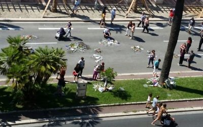 Gary and Sheila Esterman's view of the Nice boulevard where 84 people were killed by a terrorist last week. Flowers have been left by family and friends of those killed.