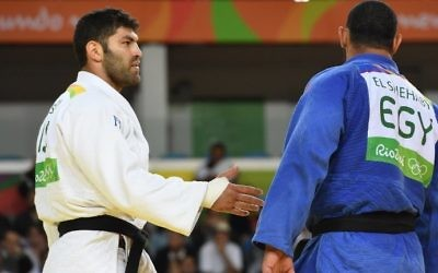 Israel's Or Sasson, left, trying to shake hands with Islam El Shehaby of Egypt following their Olympic judo match in Rio de Janeiro won by Sasson.