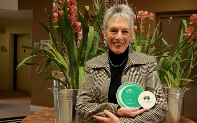 Suicide prevention advocate Dianne Gaddin with her 2016 Suicide Prevention Australia LiFE Award for individual contribution to community engagement. Photo: Shane Desiatnik.