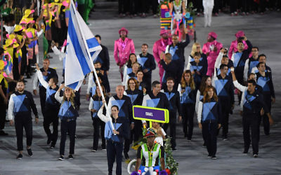 Israel's flagbearer Neta Rivkin leads her delegation during the opening ceremony of the Rio 2016 Olympic Games. (PEDRO UGARTE/AFP/Getty Images)