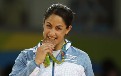 Israel's Yarden Gerbi stands on the podium after winning the bronze medal in the women's 63 kg judo competition of the 2016 Summer Olympics in Rio de Janeiro. i(AP Photo/Gregory Bull)