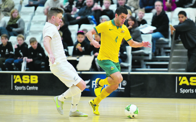 from left Futsal Whites' Josh Margetts and Futsal Roos's Jarrod Basger in action during the ASB Trans Tasman Cup - Futsal Whites v Futsal Roos at ASB Sports Centre, Wellington, New Zealand on Friday 10 July 2015. Photo : Masanori Udagawa / www.photosport.nz