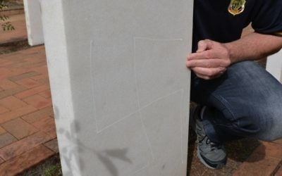 One of the swastikas drawn on the back of a headstone. Photo: South Coast Register