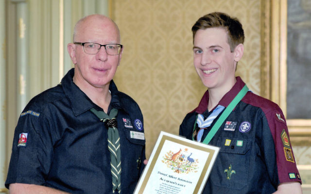 NSW Governor David Hurley presents Daniel Rotenstein with his award. Photo: Noel Kessel.
