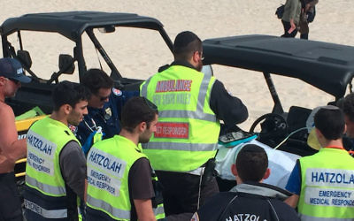 Hatzolah volunteers assist with the rescue of two Indonesian Muslim teenagers at Bondi Beach on August 30.