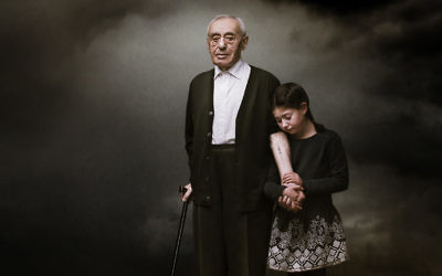 An award-winning photo of Herschel Balter and his granddaughter Tori by Kristian Piccoli.