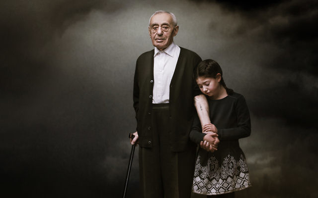 An award-winning photo of Herschel Balter and his granddaughter Tori by Kristian Piccoli.