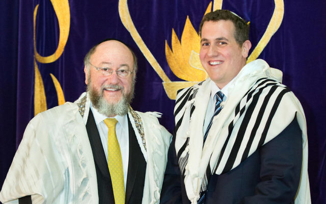 Rabbi Ephraim Mirvis with his son Rabbi Danny Mirvis at the induction ceremony at Mizrachi Synagogue.