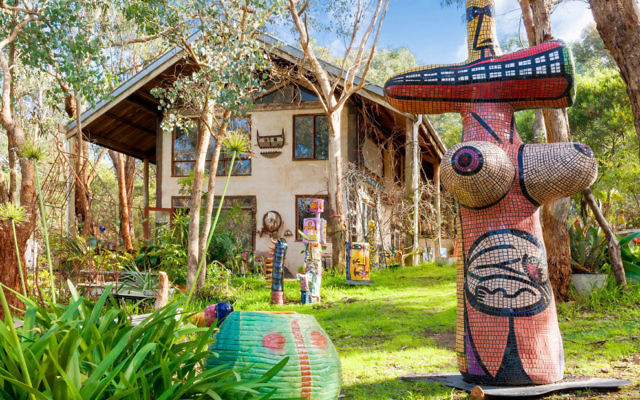 The gardens of Deborah Halpern's Warrandyte home and studio are adorned with her work, including the imposing Bosom Woman (2004) in the foreground.