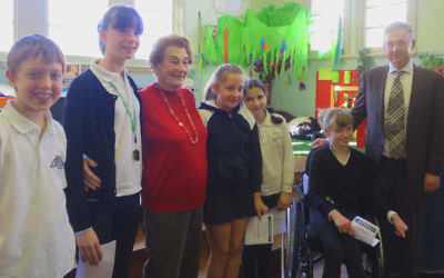 Students Joel Gross, Sarah Apfelbaum, Emily Scharrmacher, Orly Jacobs and Abigail Apfelbaum with living historian Gerty Jellinek and school principal Michael Jones.
