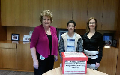 Sydney's Gidon Goodman, 13, presents his petition for hospital parking fee regulation to NSW Health Minister Jillian Skinner with Vaucluse MP Gabrielle Upton at NSW Parliament House on October 11.