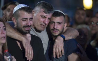 he father and brother of Israeli policeman 1st Sgt. Yosef Kirme mourning at the funeral on Mt. Herzl Military Cemetery in Jerusalem for burial 09 October 2016. Kirma was killed earlier today in a shoot out with a Palestinian from the Jerusalem area who opened fire at passenger cars in East Jerusalem, killing two people before he was killed. The Palestinian attacker, according to police, was due to start serving a jail term today for assaulting an Israeli police officer.  EPA/JIM HOLLANDER