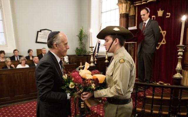 Senator Eric Abetz prepares to lay a wreath at Hobart Synagogue on October 26. Photo: Tony Lomans/Island 26