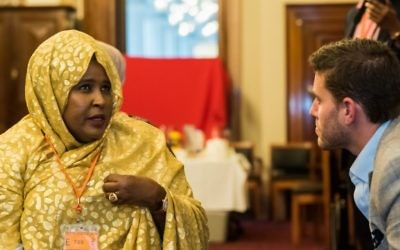 Alon Cassuto speaks with a member of Melbourne's Somali community. Photo: James McPherson Photography