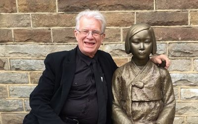 Reverend Bill Crews with the statue memorialising Korean sex slaves.