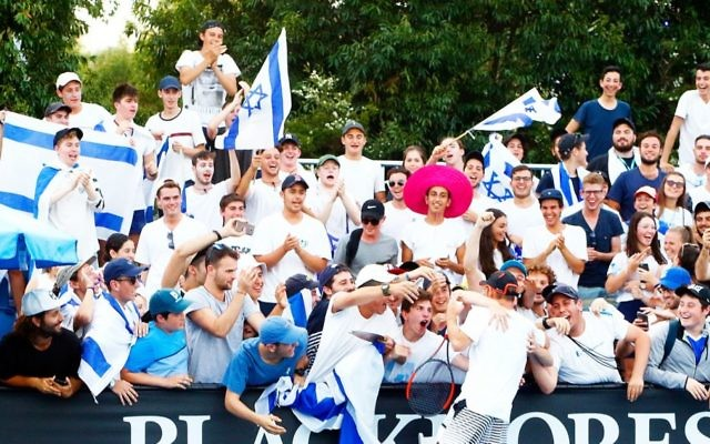 Israeli tennis player Dudi Sela surrounded by fans dressed in blue and white at the Australian Open following his first round win. Photo: Peter Haskin