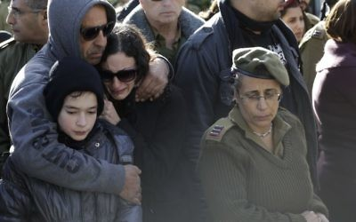 Mourners at the funeral of Israeli soldier Shir Hajaj, 22. Photo: AP Photo/Tsafrir Abayov.